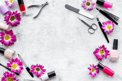 Preparing for manicure. Tools and nail polishes on grey background top view copyspace Royalty Free Stock Images