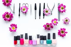 Preparing for manicure. Tools and nail polishes on white background top view copyspace Royalty Free Stock Photos
