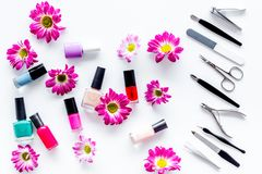 Preparing for manicure. Tools and nail polishes on white background top view Royalty Free Stock Photo