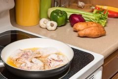 Preparing a meal at home. With fresh veggies and fried chicken Royalty Free Stock Images