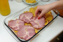 Preparing meal specialties with smoked ham.  Royalty Free Stock Photos