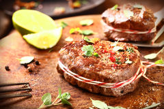 Preparing medallions of beef steak Royalty Free Stock Image