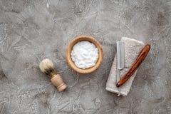 Preparing for men shaving. Shaving brush, razor, foam on grey stone table background top view copyspace Royalty Free Stock Photo