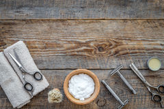 Preparing for men shaving. Shaving brush, razor, foam, sciccors on wooden table background top view copyspace Royalty Free Stock Photography