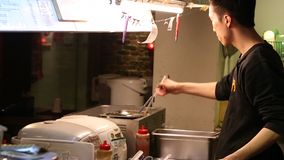 preparing Mexican food, making burritos in the kitchen of Mexican restaurant stock video footage