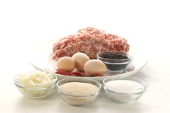 Preparing mince to make meatballs. And spices Stock Images