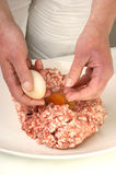 Preparing mince to make meatballs Royalty Free Stock Photos