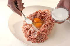 Preparing mince to make meatballs. And two hands Stock Photo