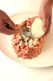 Preparing mince to make meatballs. Two hands and a spoon Stock Image