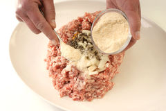 Preparing mince to make meatballs Royalty Free Stock Images