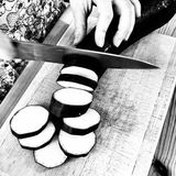 Preparing Moussaka. Eggplant. Artistic look in black and white. Royalty Free Stock Images