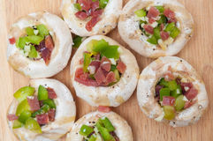 Preparing mushrooms stuffed with ham and pepper Royalty Free Stock Image