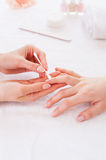Preparing nails for manicure. Royalty Free Stock Photos