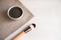 Natural cosmetic facial mask in ceramic bowl. stock photo