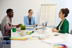 Preparing new design project. Briefing of intercultural managers or young leaders royalty free stock photography