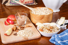 Preparing Oatmeal with Nuts and Spices Stock Images