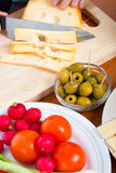 Preparing olives and emmenthal cheese Stock Images