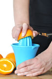 Preparing 100% orange juice Stock Image