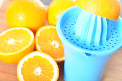 Preparing 100% orange juice Royalty Free Stock Image