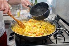 Preparing Paella - Spanish cuisine Stock Images