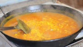 Preparing paella. Spanish traditional food. stock video