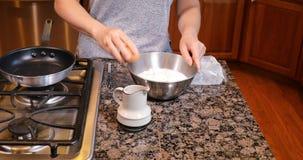 Preparing pancake batter for morning breakfast stock video
