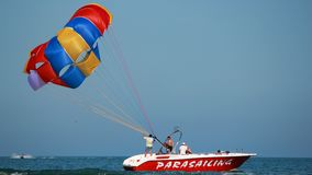 Preparing the parasail chute. Men preparing the parasil chute - before take off Stock Photography