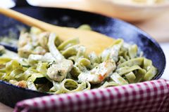 Preparing pasta dish Royalty Free Stock Images