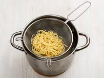 Preparing pasta. Macaroni in the colander. Food. Preparing pasta. Macaroni in the colander royalty free stock photos