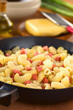 Preparing Pasta with Sausages Stock Images