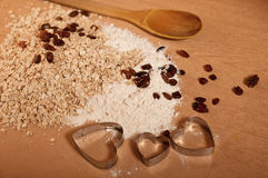 Preparing the pastry to make small cakes. With nuts and raisins Stock Photography