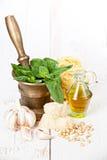 Preparing pesto in mortar Royalty Free Stock Images
