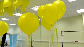 Preparing for a photo-vido shooting. Design Studio with balloons.  stock video footage