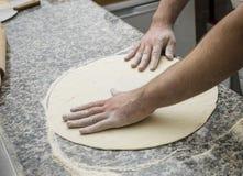 Preparing pizza. Authentic Italian   preparing a pizza Stock Photo