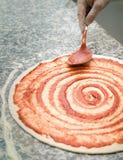 Preparing pizza. Authentic Italian   preparing a pizza Stock Image