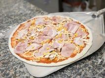 Preparing pizza. Authentic Italian   preparing a pizza Stock Images
