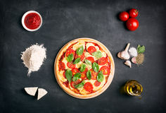 Preparing pizza (margherita). Raw ingredients Stock Photography