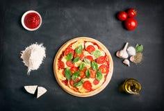 Preparing pizza (margherita). Raw ingredients Stock Photos