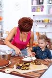 Preparing a plum cake Stock Images