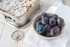Preparing plums for cake Royalty Free Stock Photography
