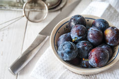 Preparing plums for cake Royalty Free Stock Image