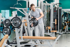 Preparing for power exercises. Young and handsome athletic man l Royalty Free Stock Photos