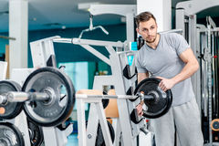 Preparing for power exercises. Young and handsome athletic man l Stock Images