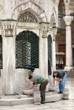 Preparing for prayer in Istanbul Stock Images