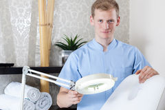 Preparing professional equipment for skin treatment Royalty Free Stock Photography