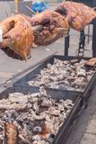 Preparing a ram on a spit. On the street Stock Image