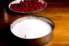 Preparing raspberry cake Royalty Free Stock Photos
