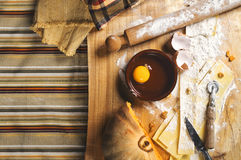 Preparing ravioli in the kitchen with tools and ingredients. Woman`s hand detail, preparing ravioli in the kitchen with tools and ingredients : dough, flour Royalty Free Stock Photo