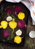 Preparing raw beetroots and garlic for roasting. Stock Images
