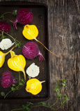 Preparing raw beetroots and garlic for roasting. Stock Photo